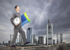 Man holding pillow and clock sleepwalking on a rope